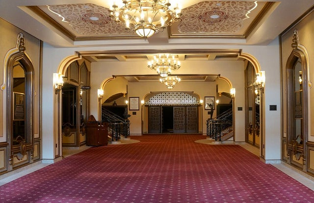 The lavish, gilded lobby of the Granada Theater