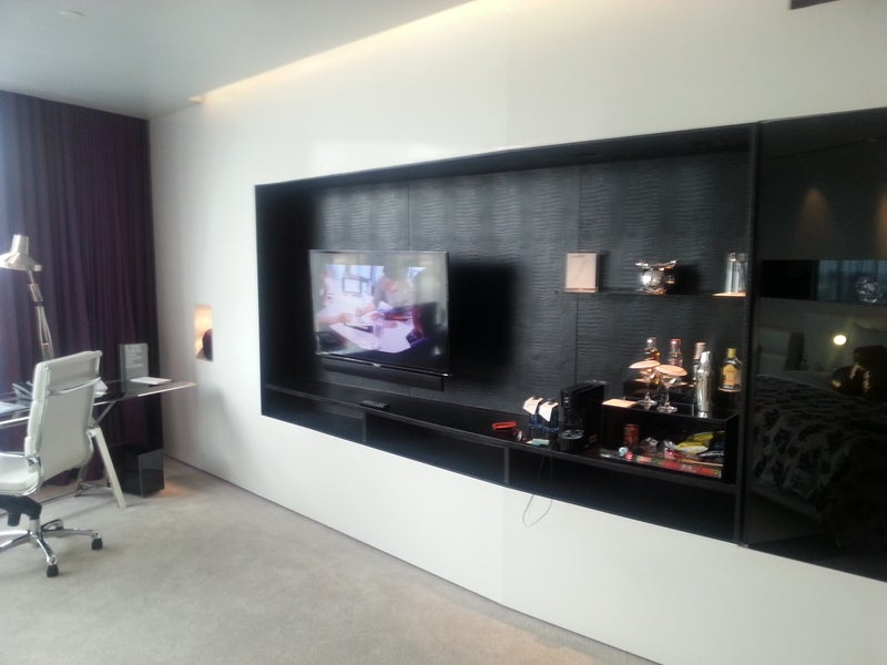 The TV and mini bar are of the room