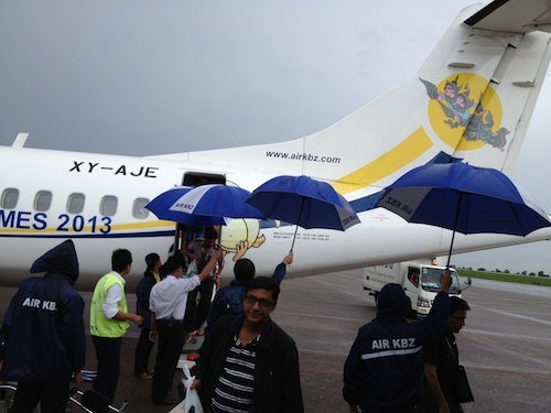 The Air KBZ staff was waiting for us on the tarmac with umbrellas.