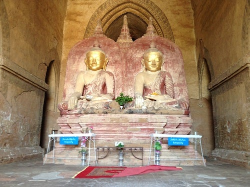 The double Buddha sculpture at Dhammayangyi is fascinating.