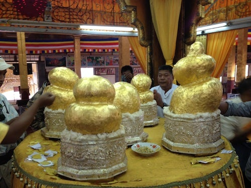 Admiring the gold-covered buddhas at Phaung Daw Oo Paya.