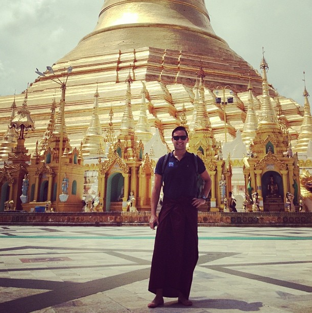 Trying on a local longyi during my visit to Shwedagon Pagoda.