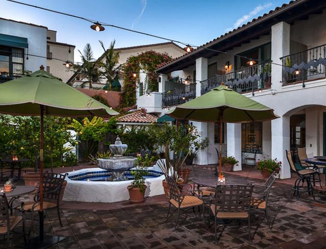 A lush garden courtyard lies at the center of the Spanish Garden Inn