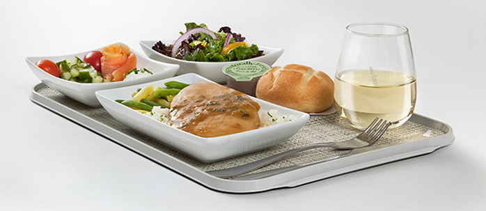 American's First Class dining service includes full meals on flights longer than