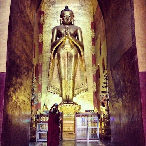 One of the enormous wooden Buddhas at Ananda.