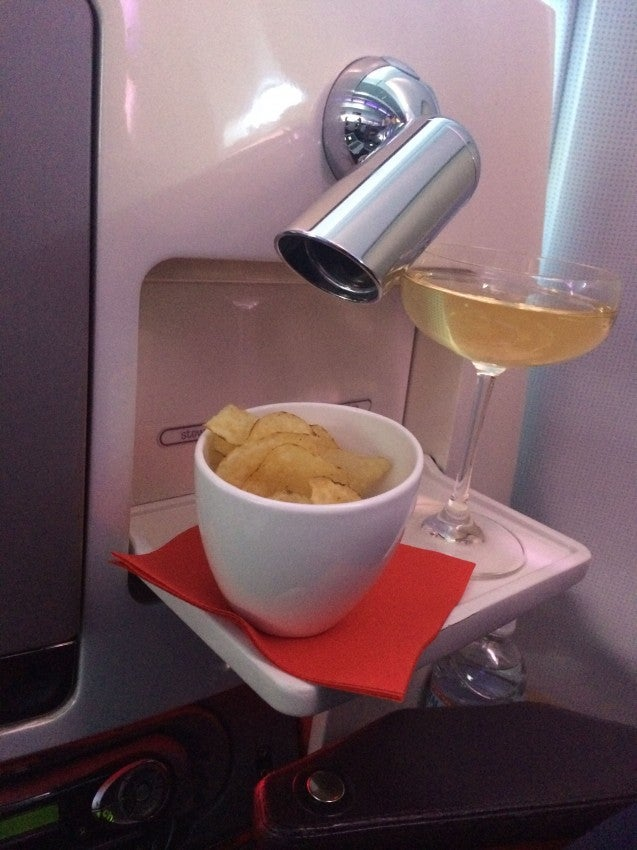 A delicious take-off combo: salty potato chips and champers in an old-school glass