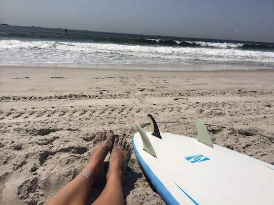 """Toes in the sand after my session with my trusty 8'0"""" soft top"""