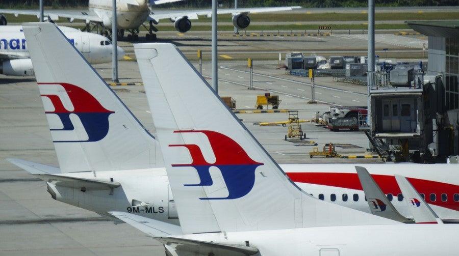 Image of Malaysia Airlines' planes at Kuala Lumpur International Airport (KUL) courtesy of Faiz Zaki/Shutterstock