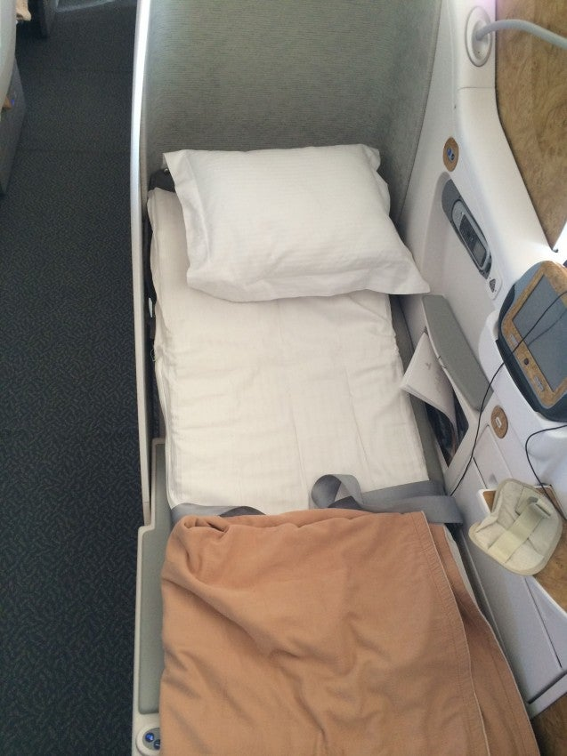 Pretty decent mattress pad for an airline seat, even if it's not entirely lie-flat