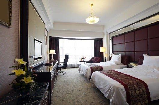 Most American hotels have rooms that sleep four, bu they are hard to find in other countries. (Image courtesy of ShutterStock)