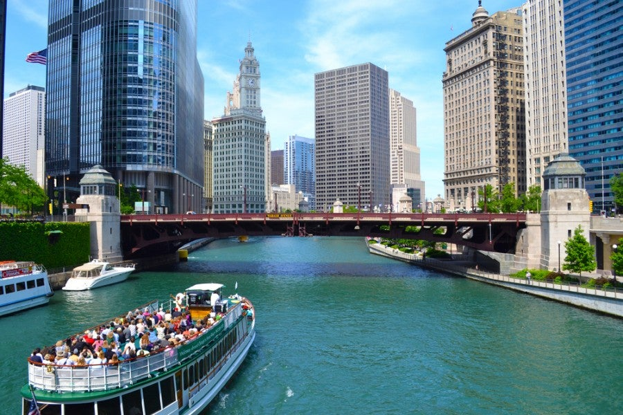 While in Chicago, don't miss a chance to get on the river and tour the city by boat (photo courtesy of Shutterstock)
