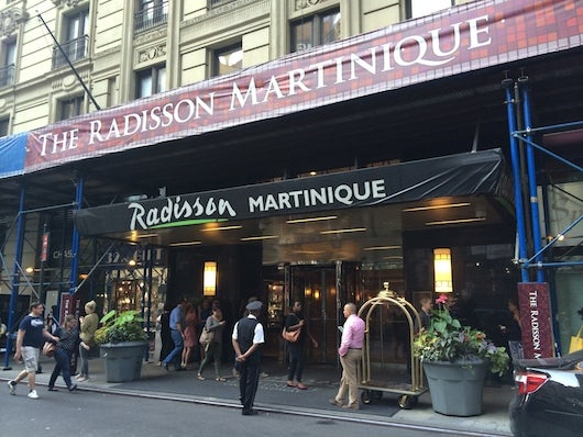 The Radisson Martinique on Broadway's facade, covered in scaffolding at the moment