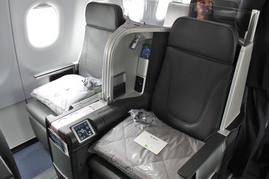 JetBlue Mint seats laid with handwritten notes and plush duvet sets