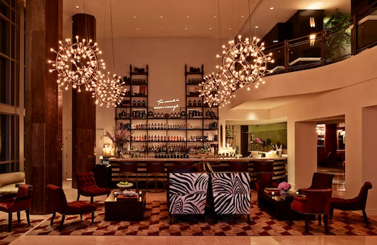 """""""Too much is never enough,"""" a quote by Morris Lapidus above The Drawing Room bar."""