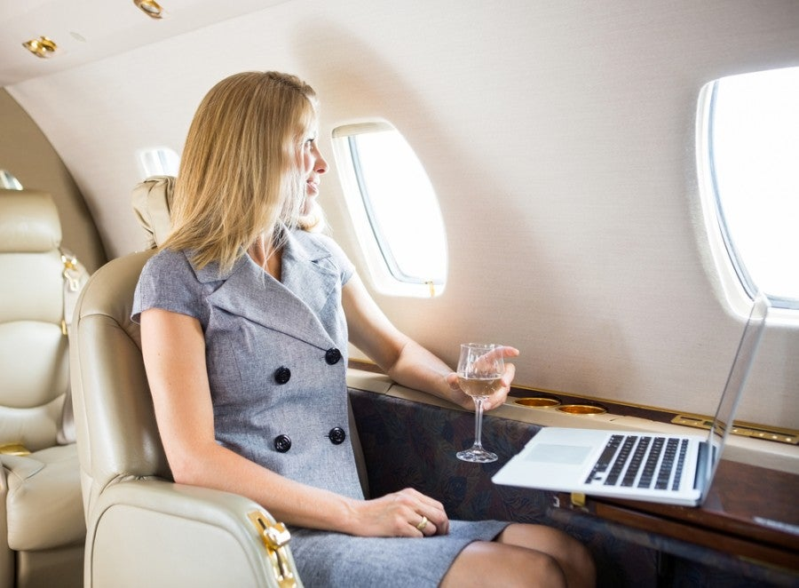 If you get an upgrade, don't feel bad! Your boss will be fine in economy... Photo courtesy of Shutterstock.