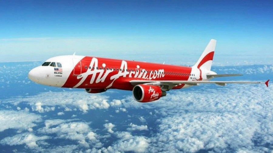 As debris and bodies from a missing AirAsia plane were fund near Borneo, another AirAsia plane overshot a runway amidst high winds in the Philippines.