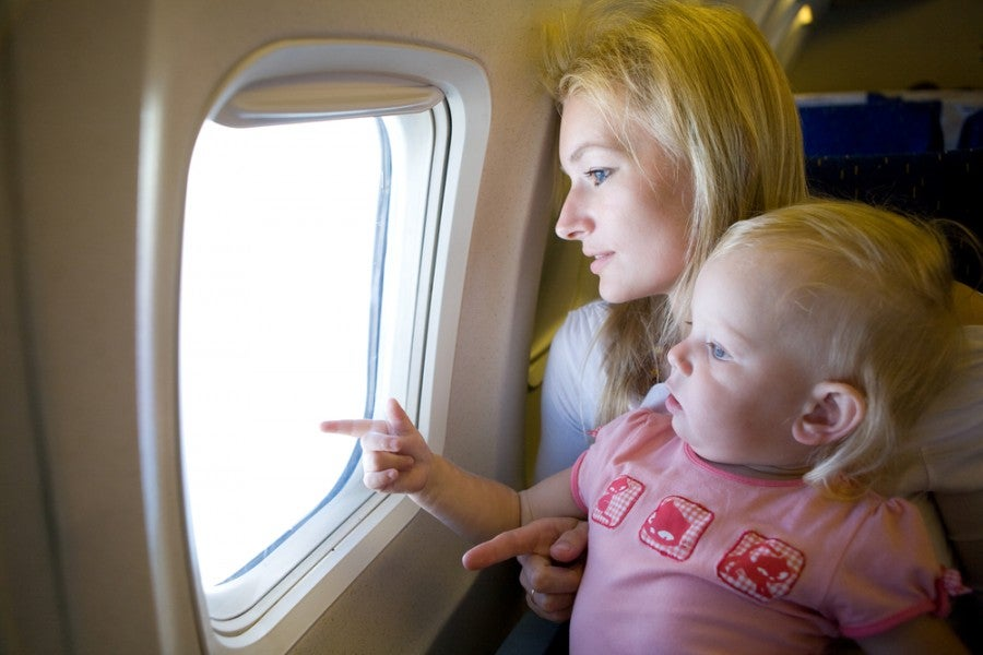 Baby Airplane Family Shutterstock 31621051