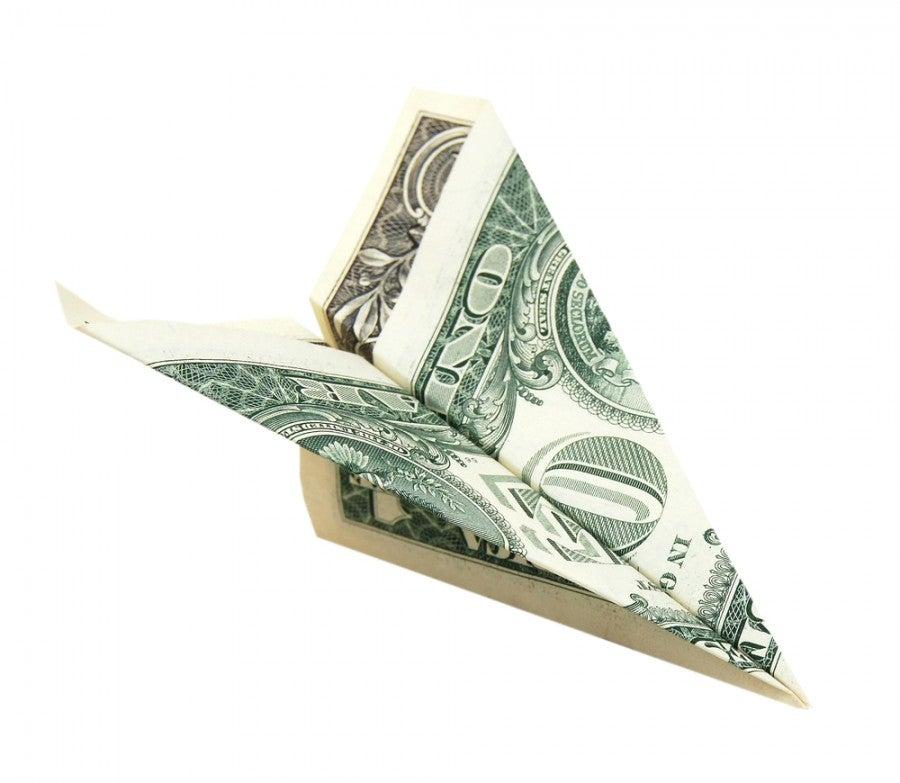 Dollar paper airplane Shutterstock 117458416