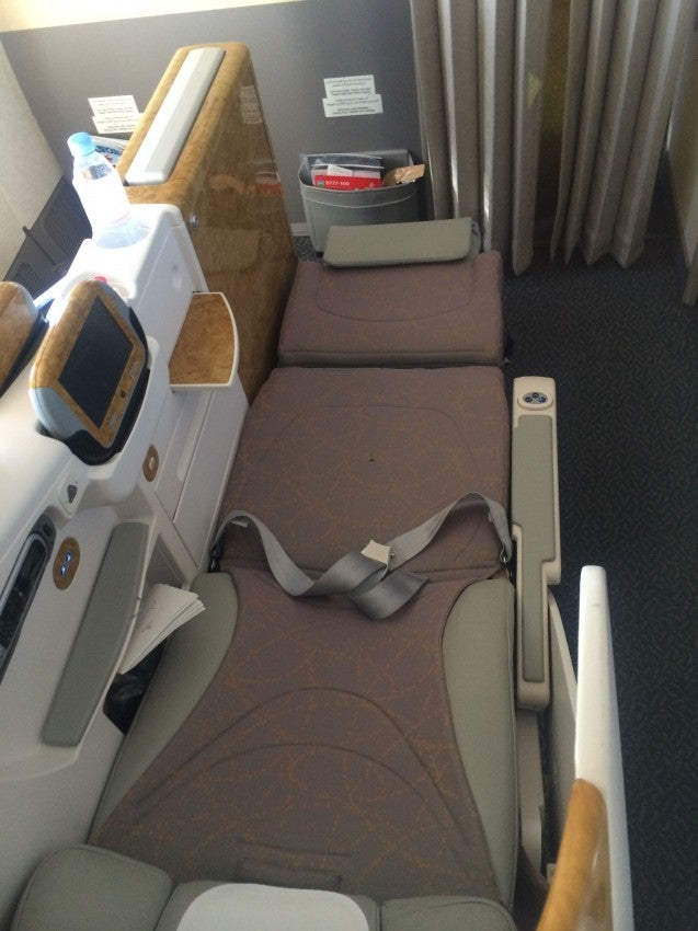 """Emirates business class is an """"almost"""" lie-flat long seat"""