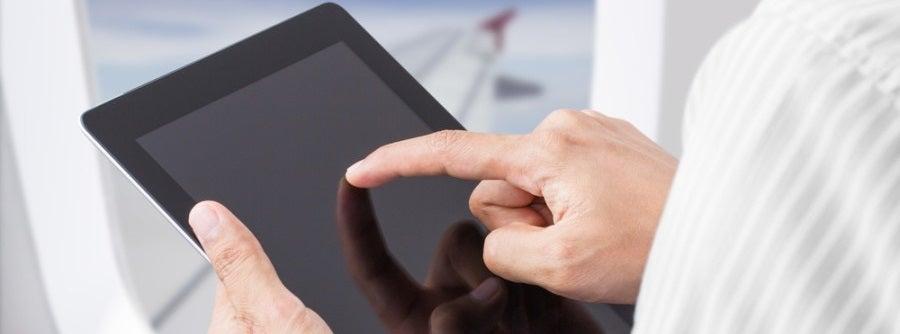 Ipad on airplane wifi featured shutterstock
