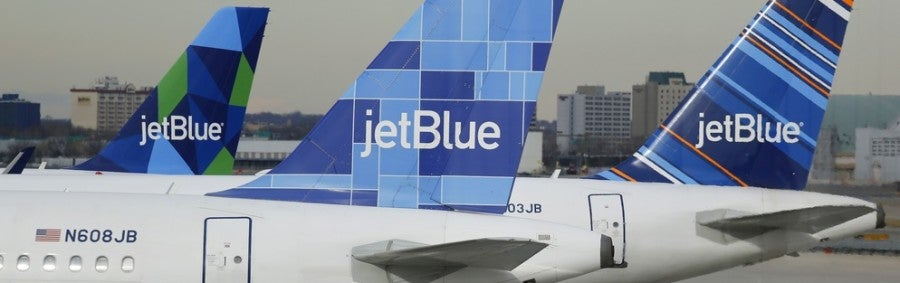 JetBlue planes tails featured shutterstock 242658286