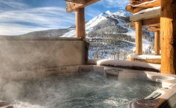 Enjoy a winter jacuzzi in a mountain-side Montana cabin found on VRBO.