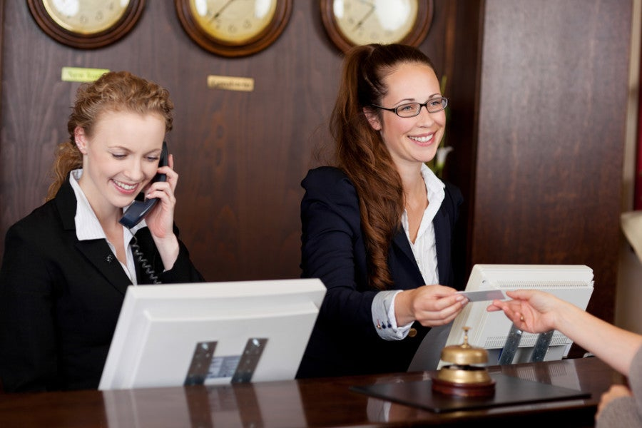 Front desk staff at a hotel won't be able to tell how you got your elite status, and shouldn't treat you any differently. Photo courtesy of Shutterstock.