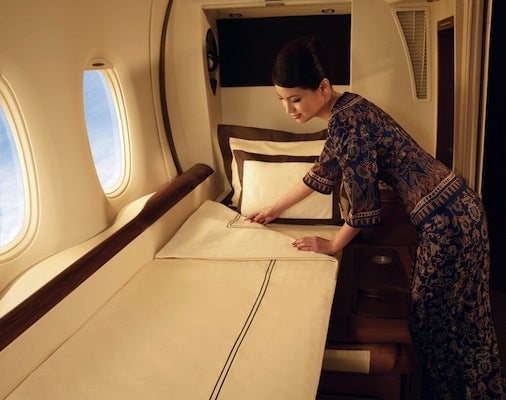 Turn down service in the Singapore Airlines First Class suite (with Givenchy linens!)