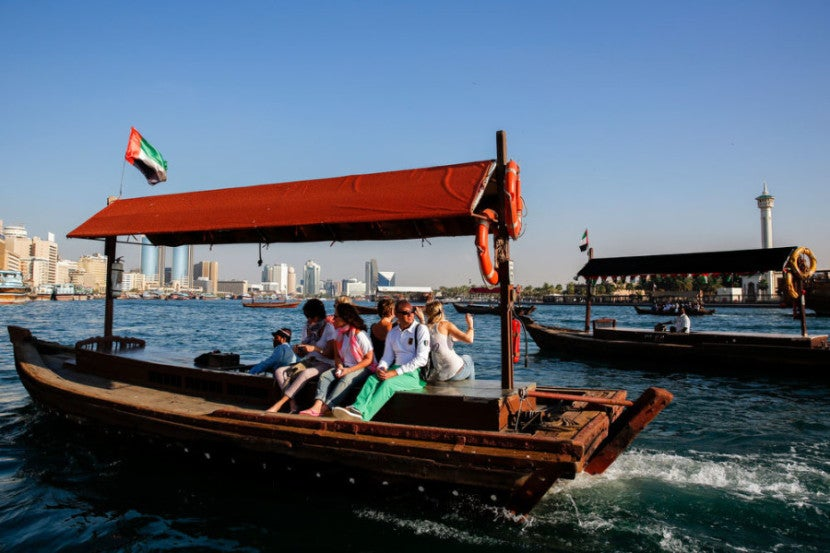 Tourists ride the Abra water taxis, quite possibly the least expensive attraction in all of Dubai, at sunset at the Old Souk on Dubai Creek on Tuesday, January 21, 2014 in Dubai, United Arab Emirates. © 2014 Patrick T. Fallon - All Rights Reserved, No Use Without Permission