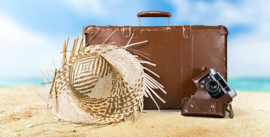 Make sure to pack one of these travel rewards cards in your suitcase this summer! Photo courtesy of Shutterstock.