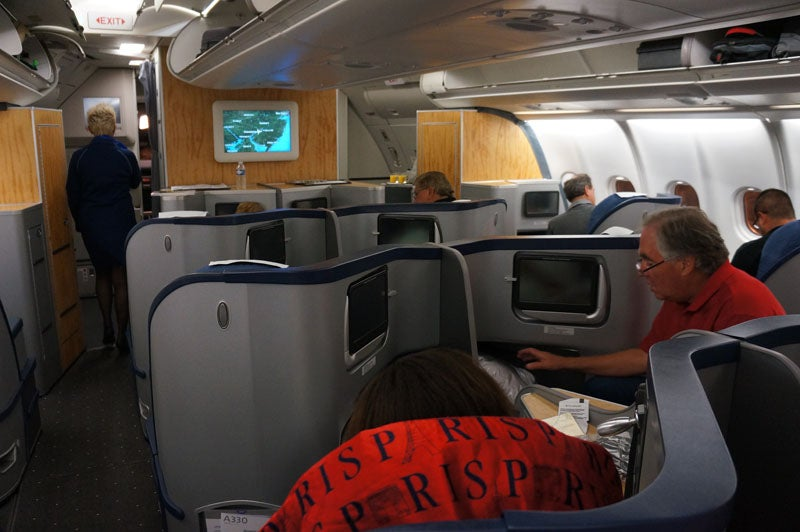 an overview of the business class cabin on us airways a330 as seen from seat