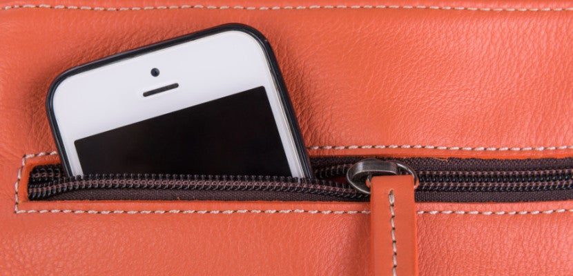 orange purse phone shutterstock_247059376