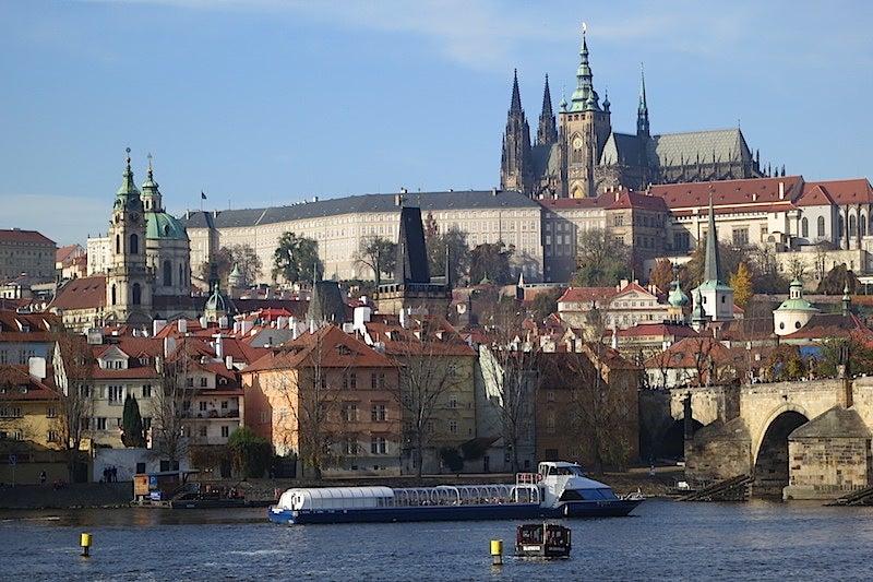 Prague Castle anchors the hills of Malá Strana skyline across the Vltava River.