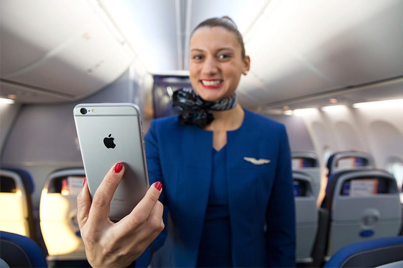 Flight attendants can offer upset customers snacks and drinks.