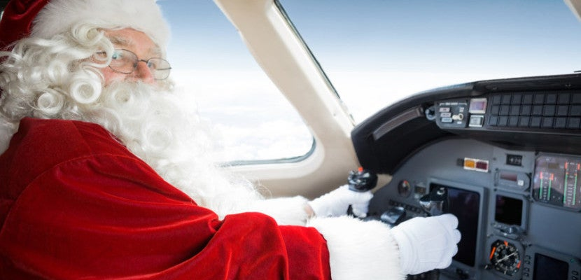 Santa Flying a Plane Featured