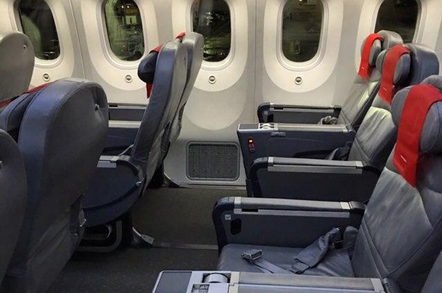 Norwegian Looking Across A Row Of Seats In The Premium Cabin.
