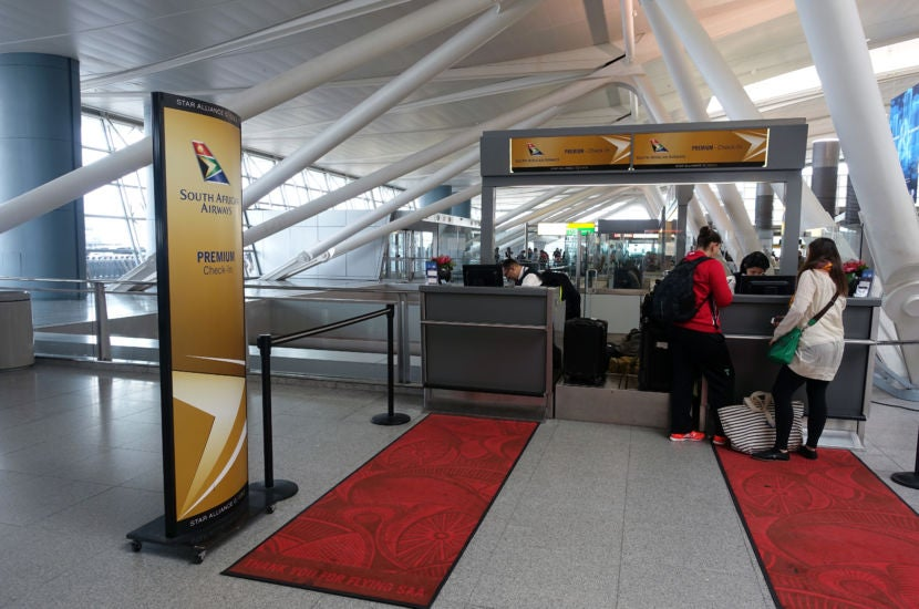 The premium passenger check-in counter was located off to the side, closest to