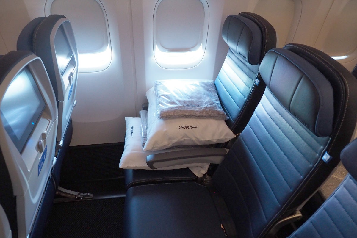 where to sit when flying united s 777 300er economy a window seat in the mini cabin 21l is pictured below note that economy passengers do not receive saks fifth avenue pillows and blankets they were only