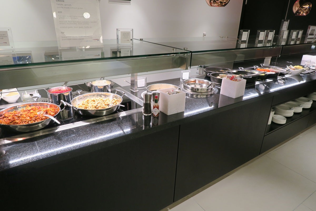 First look inside the new british airways lounge at bos for Food bar food