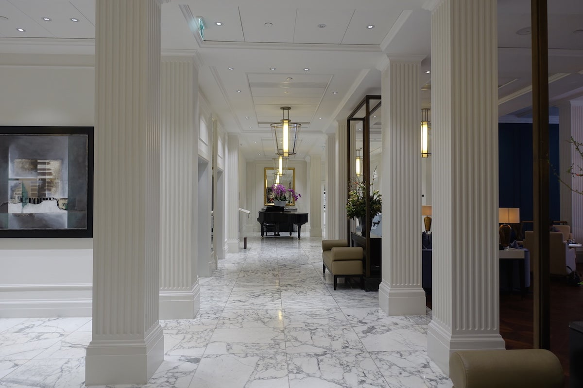 Hallway leading to the ladies rooms - I Was Greeted Warmly At Reception By The Young Lady Working There And I Handed Over My Passport And Waited To Hear About My Room Right Off The Bat