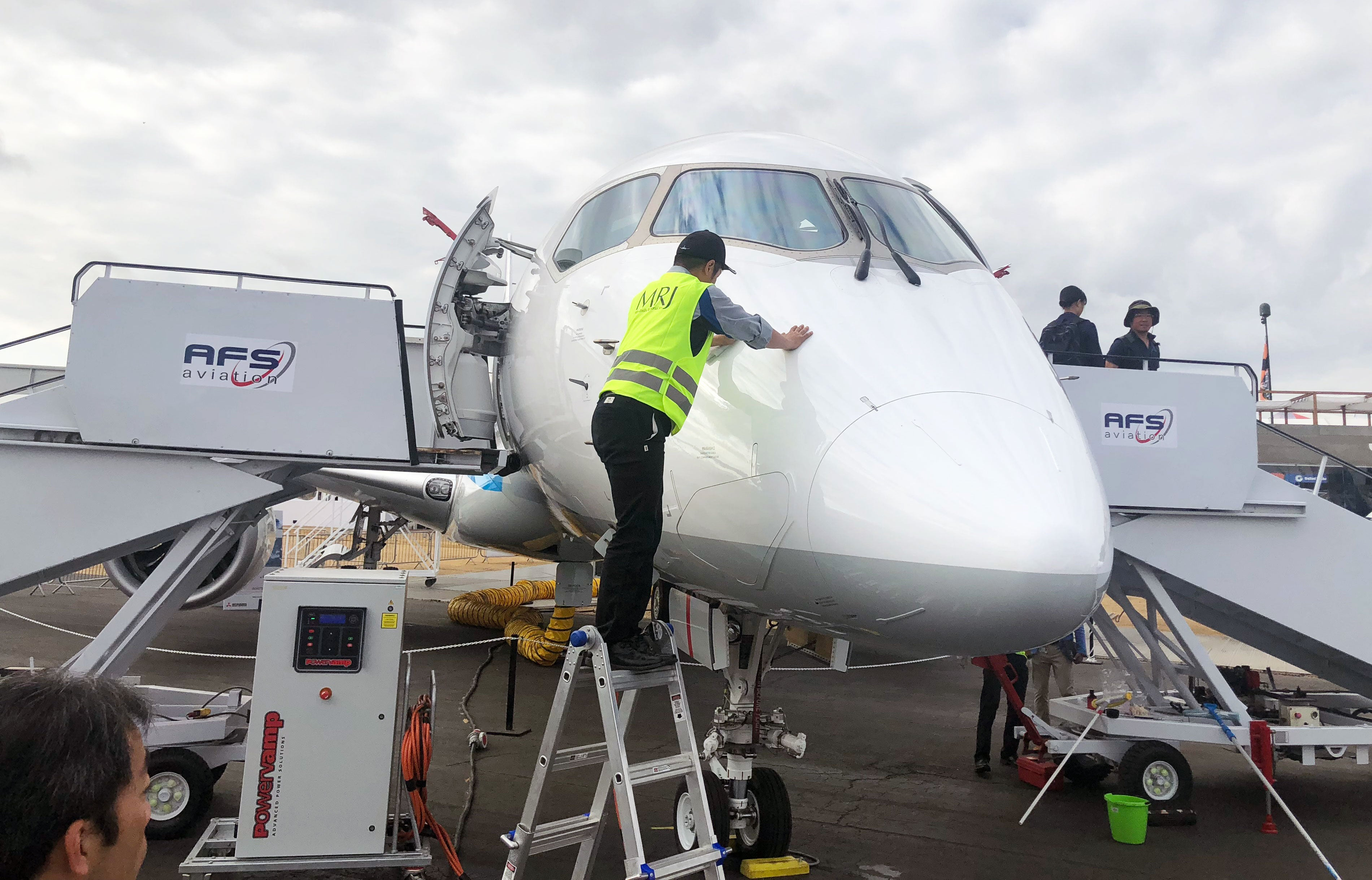 A Mitsubishi MRJ900 being spot cleaned at Farnborough. Image by author.