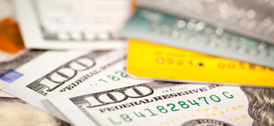 Credit cards and cash featured shutterstock 196399979