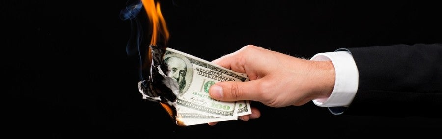 Burning money featured shutterstock 245479693