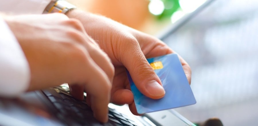 Credit Card laptop shutterstock 114439639